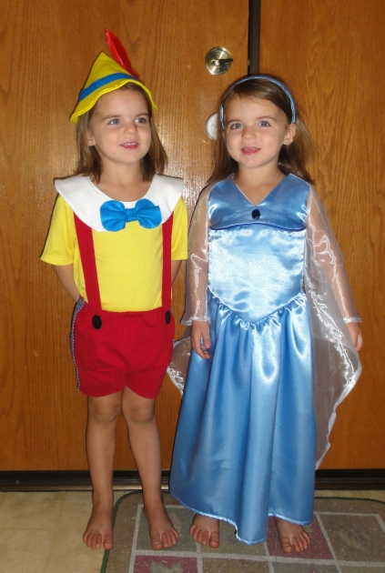 And just to mess with you, here they are trying on each others costumes.